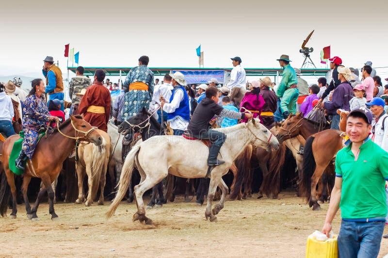 Horseback spectators watching Nadaam Horse Race royalty free stock image