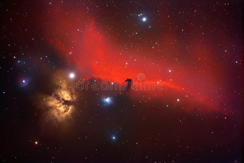 Horsehead e Flame nebulae na espada de Orion, imagem astronômica foto de stock