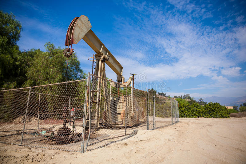 Download Horsehead Pumpjack With A Blue Sky Background Stock Image - Image: 40096099