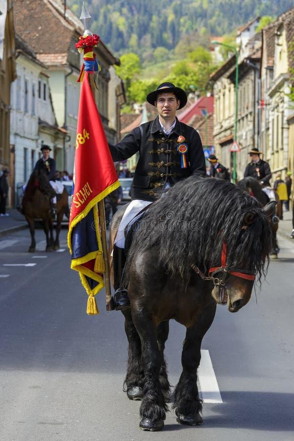 Horseman holding flag during Brasov Juni parade stock images