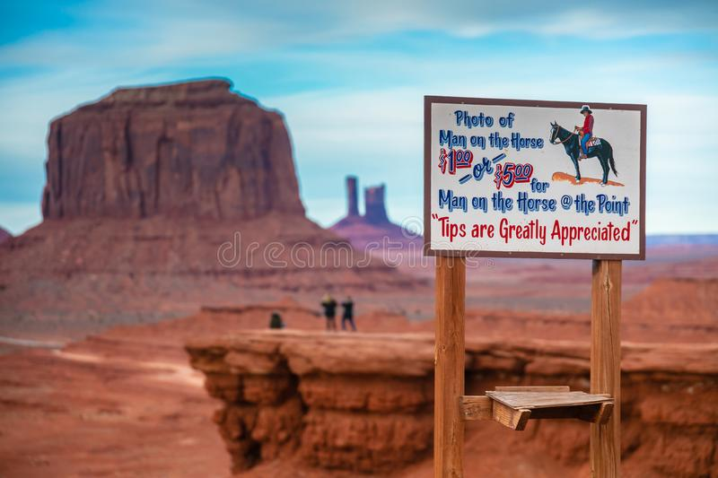 Horseman in Monument Valley, Navajo Land, Utah. A stunning landscape with a sigh advertising special service for tourists in the Monument Valley, Navajo land royalty free stock images