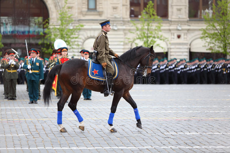 Horseman in uniform and rank soldiers near GUM. MOSCOW - MAY 6: Horseman in uniform and rank soldiers near GUM participate in rehearsal in honor of Great royalty free stock image