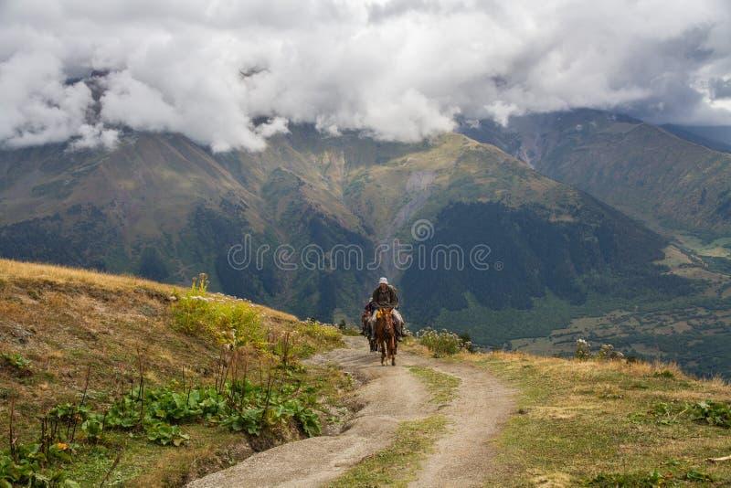 Horsemen in the mountains stock photos