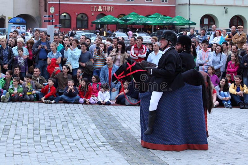 Horsemen theatrical act. Sibiu, Romania - June 11, 2013: Sibiu International Theatre Festival. The Horsemen show presented by Les Goulus theatrical group from stock images
