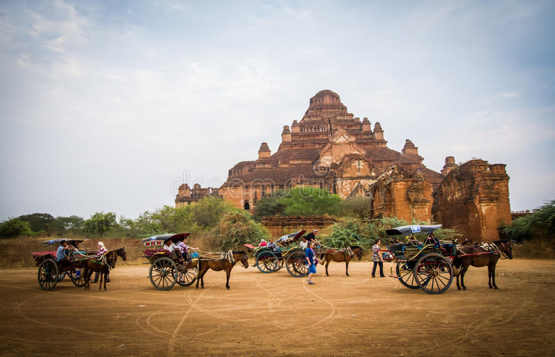 Horses buggy in Bagan. BAGAN,MYANMAR-MARCH 8: Horses buggy waiting for tourist in front of Dhammayangyi Temple in Bagan,Myanmar on March 8,2017.Horse buggy is stock image