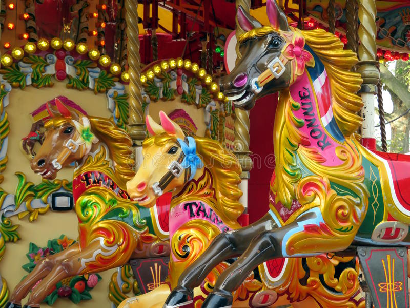 Horses on a carousel royalty free stock images