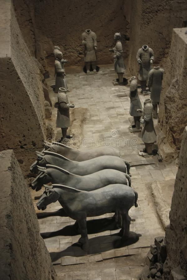 Horses in the excavation. China, Xi`an: Archaeological excavations of the clay army of the emperor Qin Shi Huang. The terracotta army is a figure of ancient royalty free stock image
