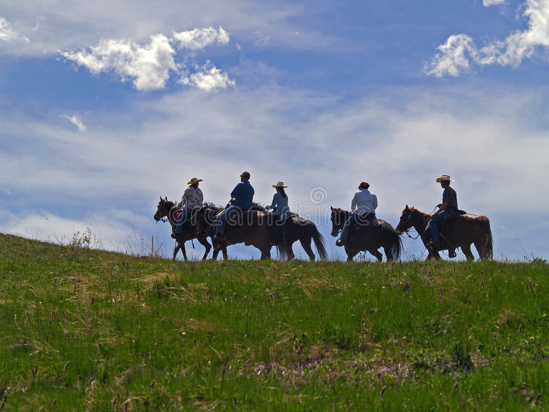 Horses and Riders on Ridge royalty free stock photography