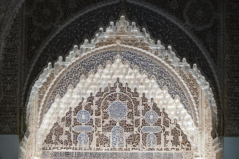 Horseshoe Arch at Lions court of Nasrid palace of the Alhambra in Granada, Andalusia. Wall decorations with arabesque ornaments at the Lions Palace of the Nasrid stock images