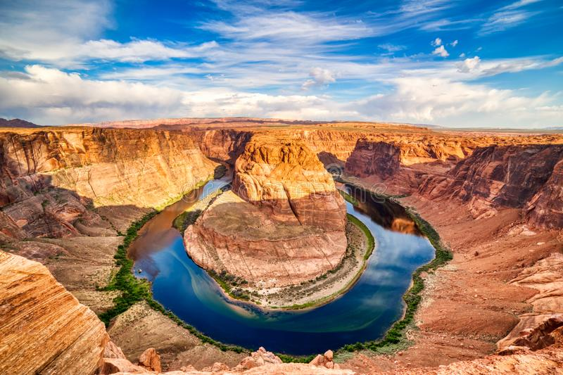 Horseshoe Bend on Colorado River at Beautiful Sunrise with Bright Blue Sky, Utah. USA stock images