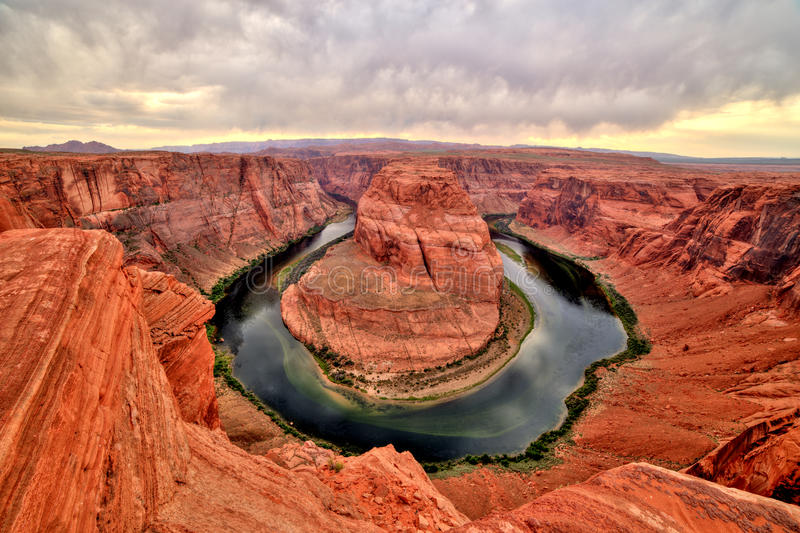 Horseshoe Bend on Colorado River at Sunset and Cloudy Weather, Utah royalty free stock photo