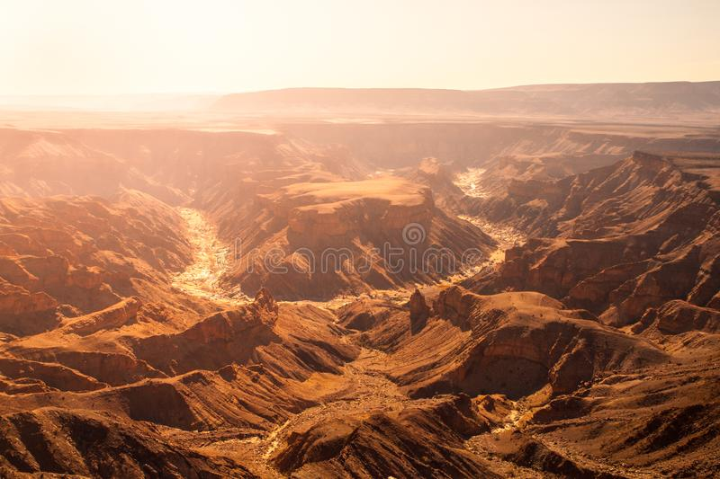 Horseshoe bend in Fish River Canyon on hot sunny day, Namibia royalty free stock image