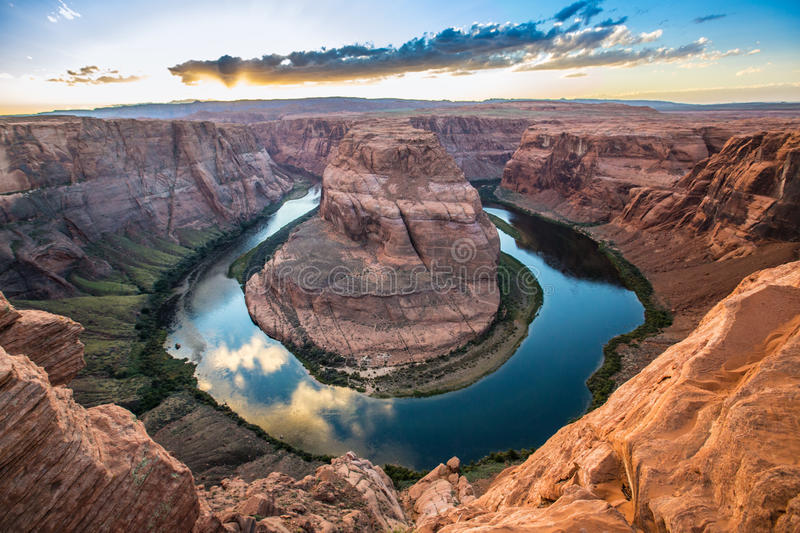 Horseshoe bend, Grand Canyon. Known as Horseshoe Bend, the Colorado River winds into a horseshoe, carving a path into the sandy red southwest desert of northern stock image