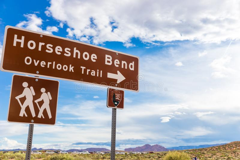 Horseshoe Bend sign pointing to overlook trail. With blue sky royalty free stock image