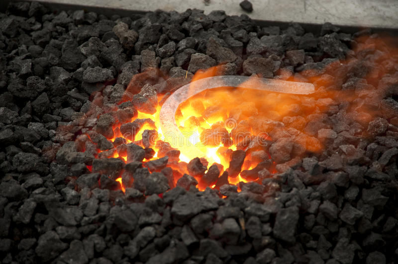 Horseshoe being heated in a forge royalty free stock photo