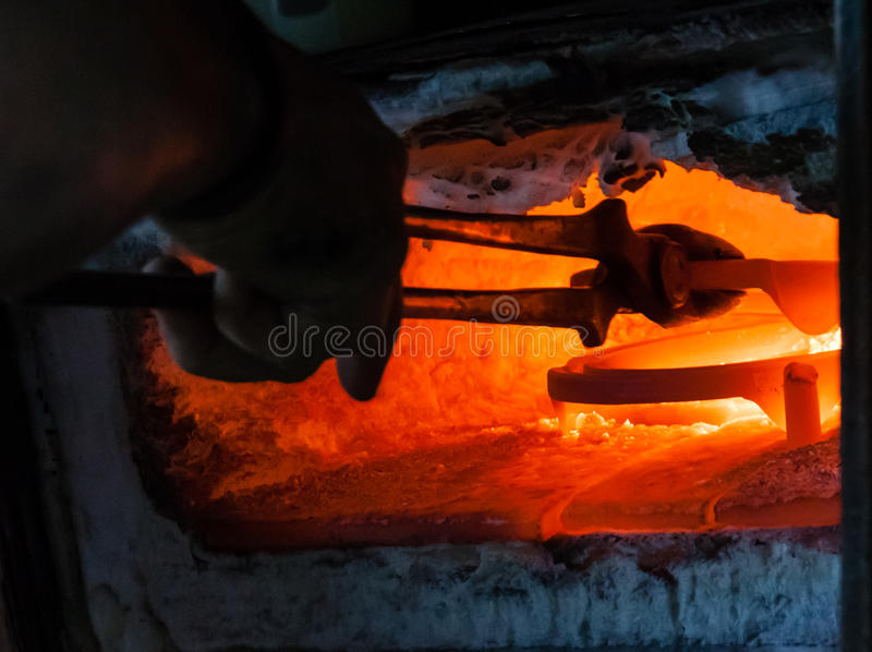 Horseshoe in the furnace stock image