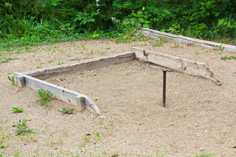 Horseshoe stakes in a sandbox area royalty free stock photos