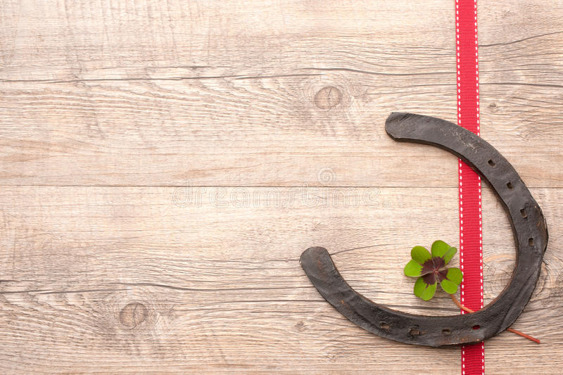 Horseshoes with clover stock images