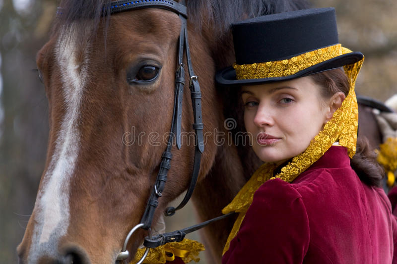 Horsewoman. In vintage stylized suit royalty free stock images