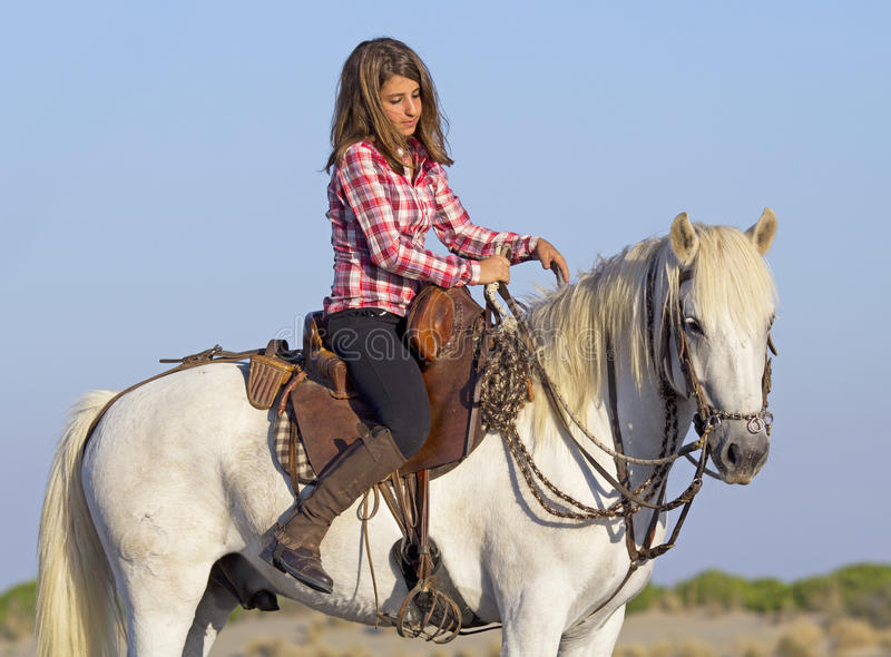 Horsewoman on the beach stock photography