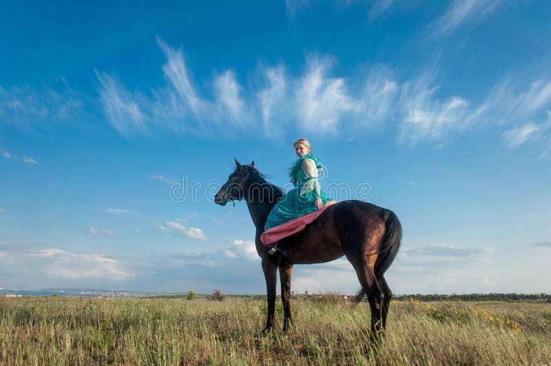 Horsewoman and blue sky royalty free stock image