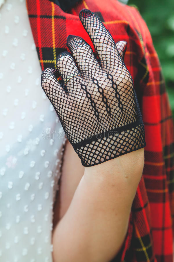 Horsewoman hand in fishnet glove stock photos