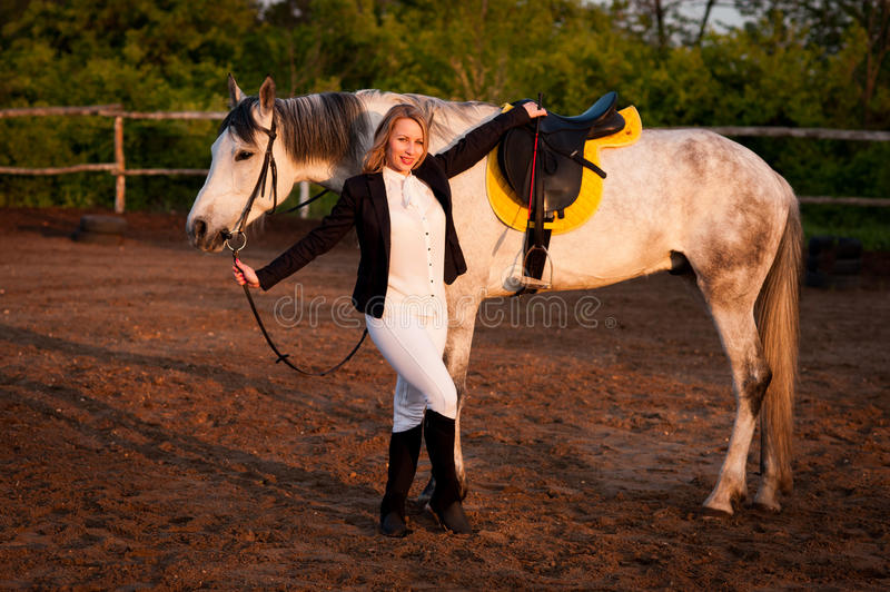 Horsewoman at hippodrome and blue sky stock images