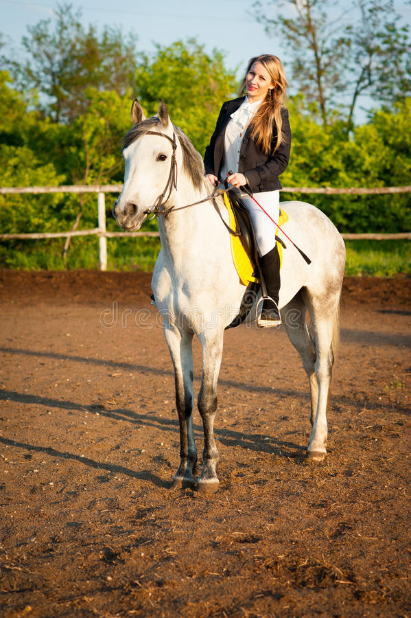 Horsewoman at hippodrome and blue sky royalty free stock image