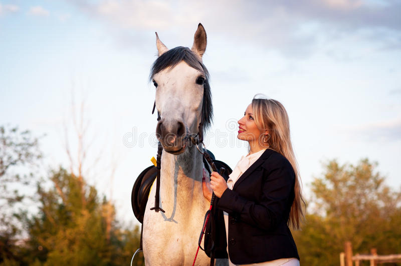 Horsewoman at hippodrome and blue sky royalty free stock photography