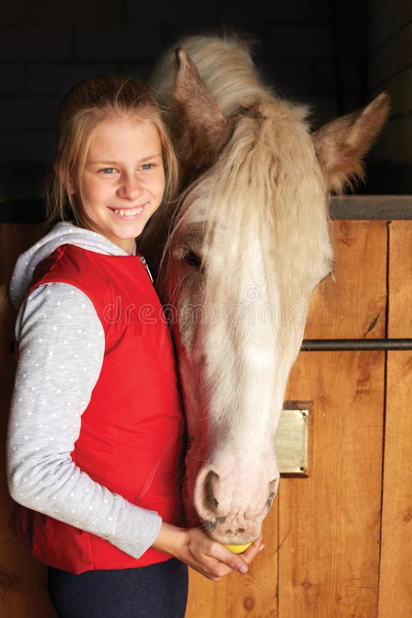 Horsewoman with his horse in the stable. Sport. Horsewoman with his horse in the stable stock image