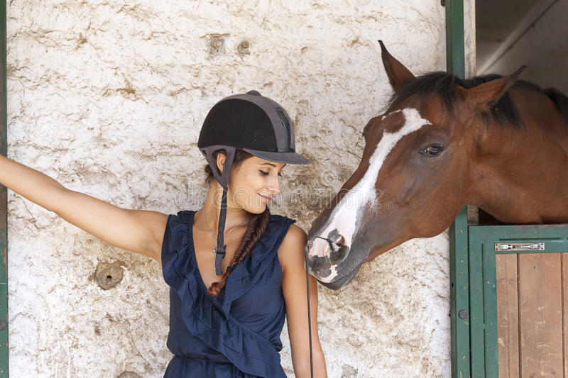 Horsewoman with his horses. In the farm royalty free stock photos
