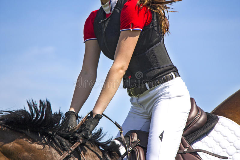 Horsewoman. A rider on horseback competing in equestrian tournament royalty free stock photo