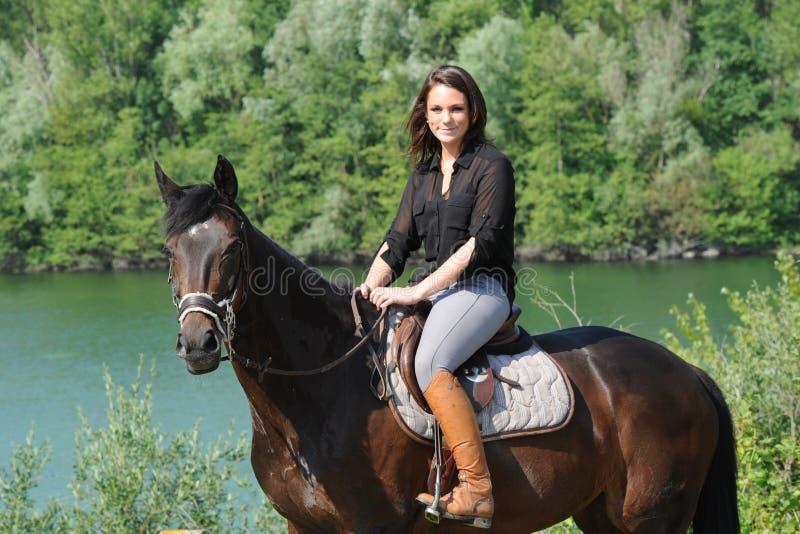 Horsewoman. Rider on horseback in the snow stock photos