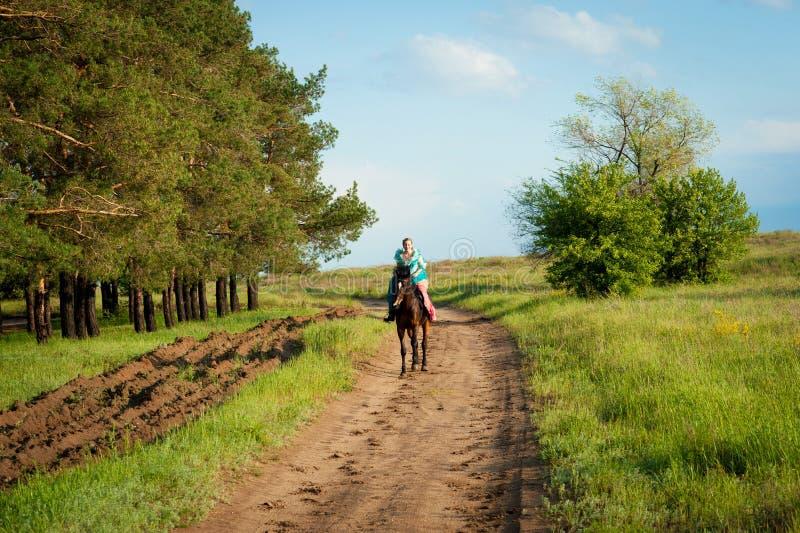 Horsewoman riding. stock photo