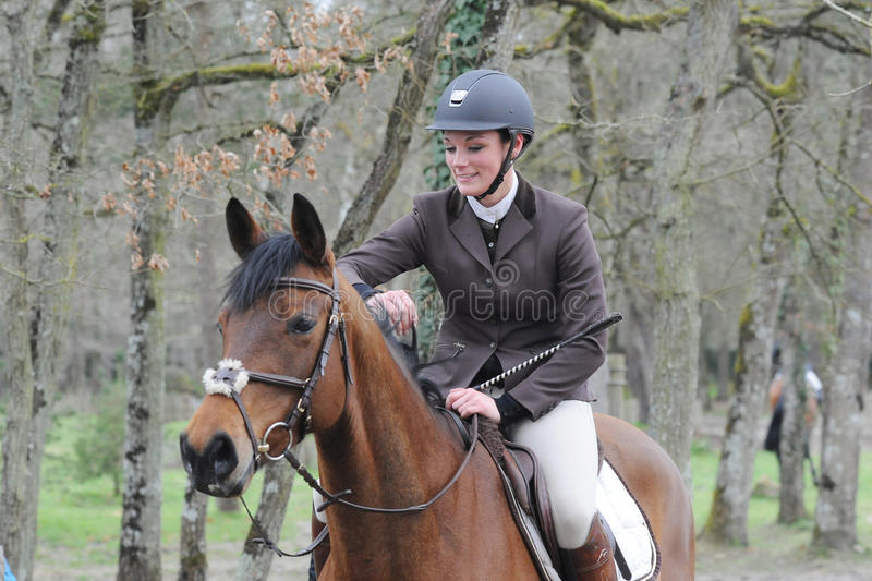 Horsewoman in show jumping. Horsewoman in fontainebleau show jumping stock photo