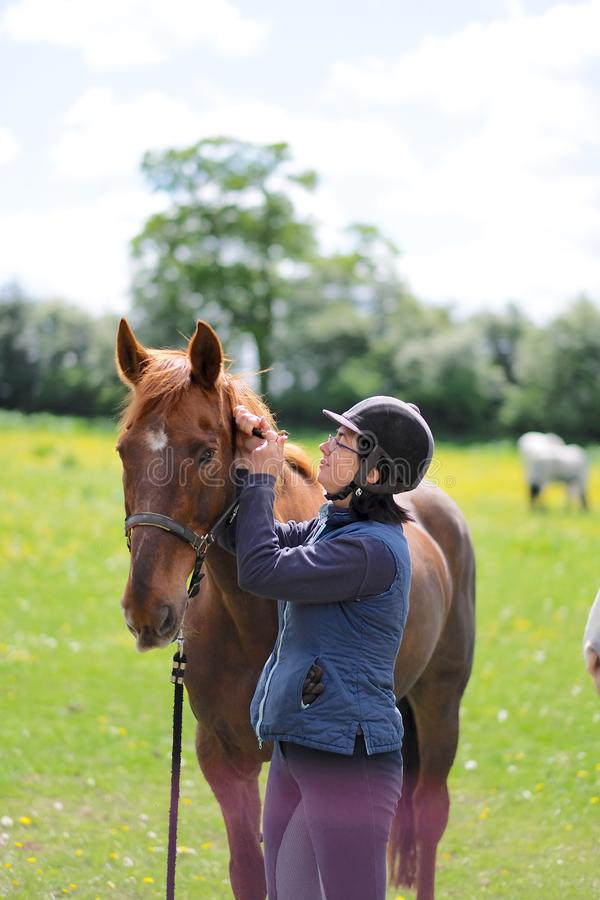 Horsewoman in special gear and horse stock photos