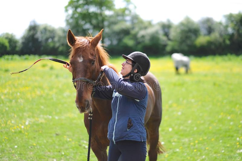 Horsewoman in special gear and horse stock image