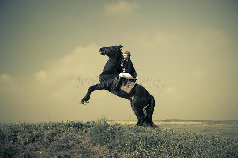 Horsewoman trains the horse / split vintage toned. Horsewoman trains the horse / split vintage retro toned royalty free stock images