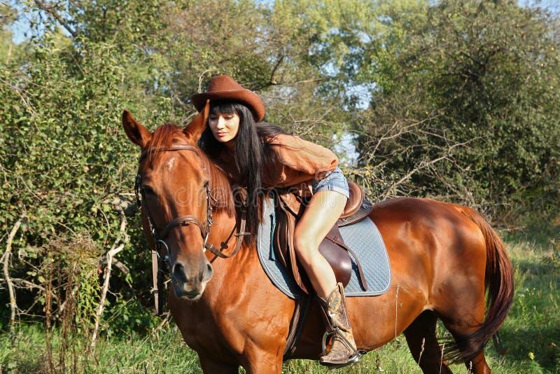 Horsewoman. Walking her horse in garden stock photography