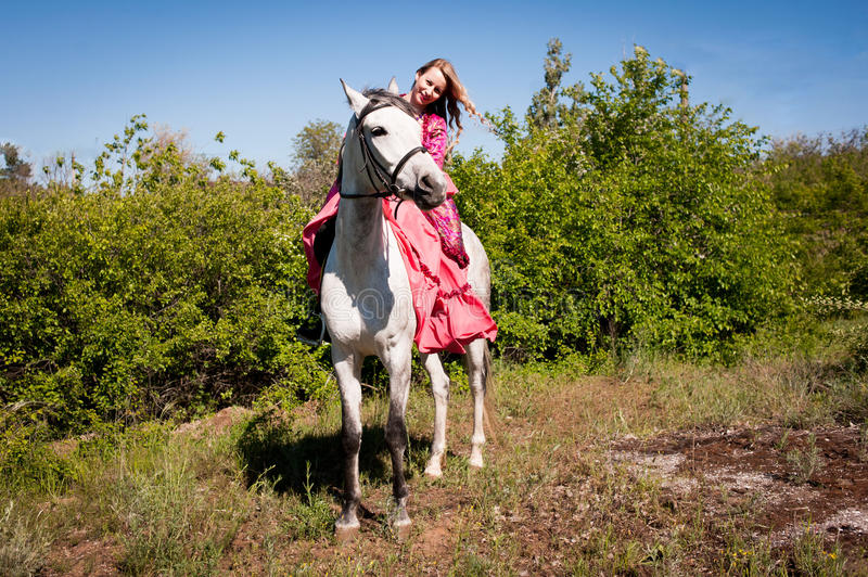 Horsewoman on white horse royalty free stock images