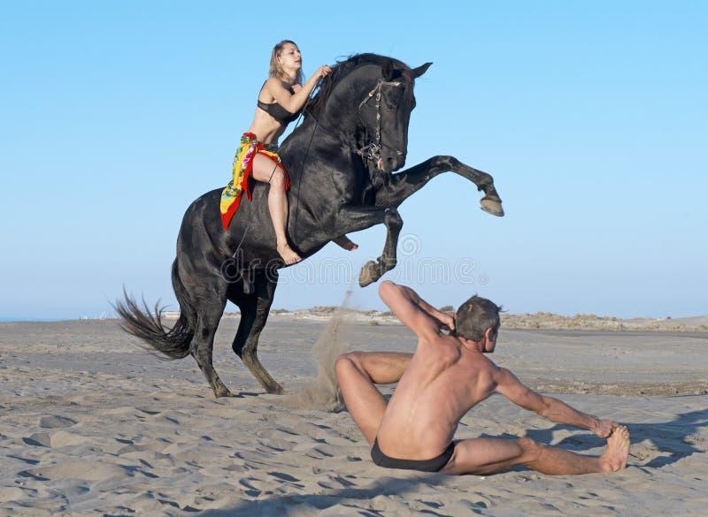Horsewoman and yogi royalty free stock photography