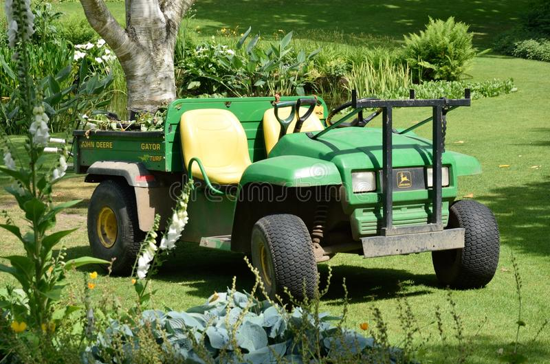 Horticultural tractor in garden. ESSEX UK 7 JUNE 2015: Horticultural tractor in garden stock photo