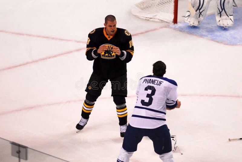 Horton v. Phaneuf. Bruins Forward Nathan Horton squares up and prepares to battle Leafs Captain Dion Phaneuf royalty free stock photo