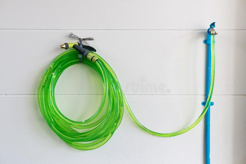 Hose green with nature. Open the valve with water to provide water for injection. royalty free stock images