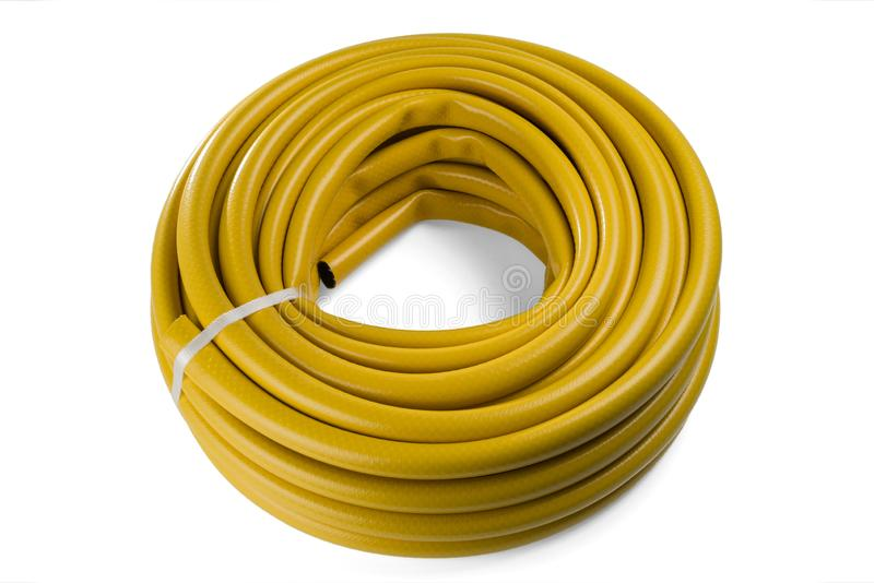 Hose for watering yellow color. Garden hose in a skein. royalty free stock photography