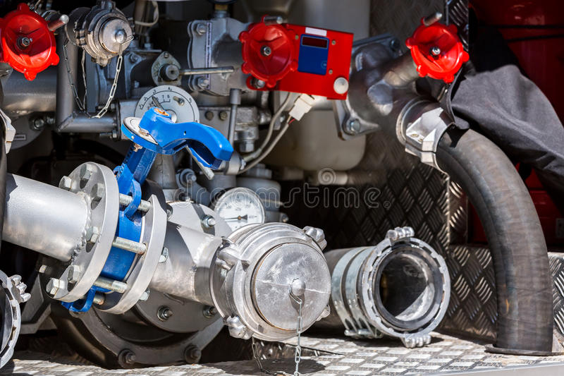 Hoses, valves and pressure gauges on rear of fire engine royalty free stock photo