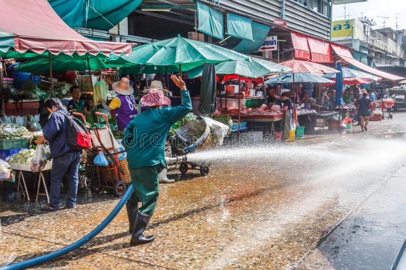 Hosing down at Khlong Toei market royalty free stock images