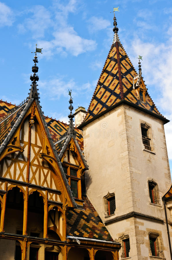Hospice at Beaune. Tiled Rooftops at the Hotel-Dieu in Beaune, France stock image