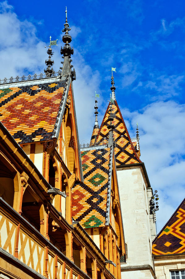 Hospice at Beaune. Tiled Rooftops at the Hotel-Dieu in Beaune, France royalty free stock images