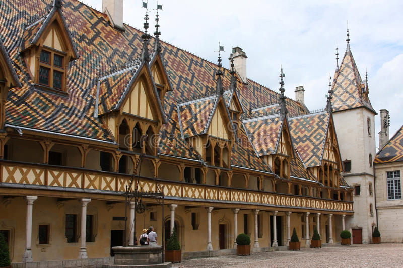Hospices in Beaune. Polychrome roofs of the hospital for the poor in Beaune, Burgundy stock photography